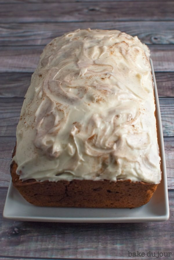 Pumpkin Bread with Cream Cheese Frosting - loaf topped with cream cheese frosting