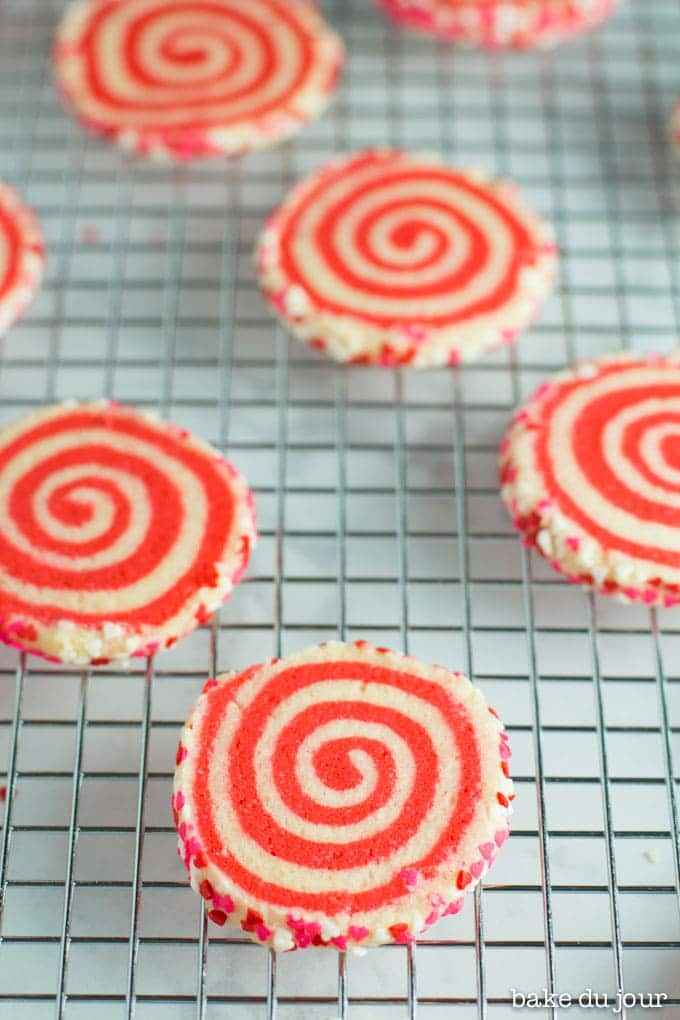 Valentine's Day Pinwheel Cookies laid out on cooling rack