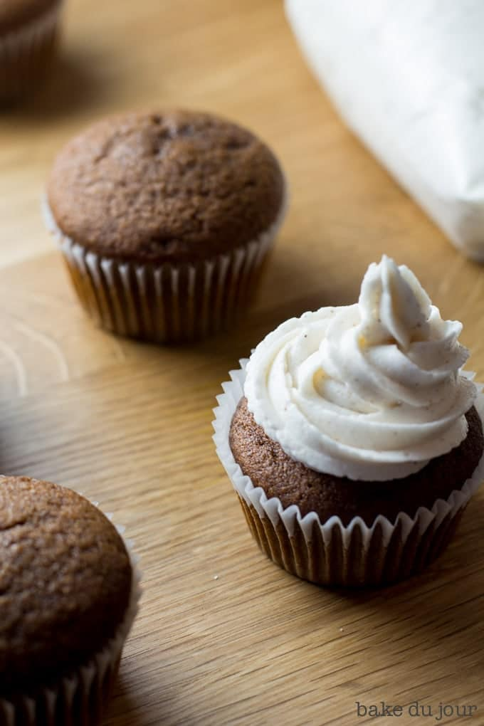 Frosting the Gingerbread Eggnog Cupcakes