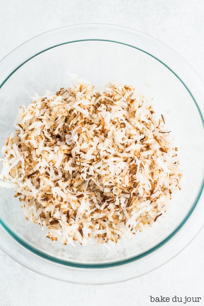 A bowl of toasted coconut flakes