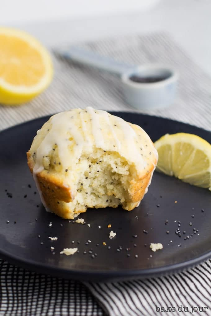 A Lemon Poppy Seed Muffin with a bite taken out of it