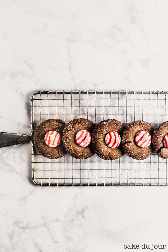 A set of five Chocolate Peppermint Blossom Cookies on cooling rack
